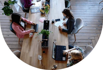 Aerial view of people working at a desk