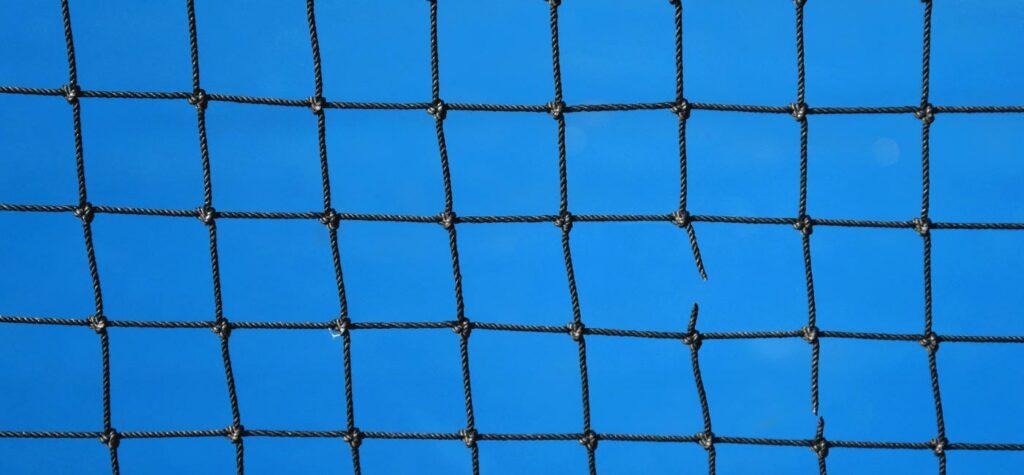Tennis net with one broken piece